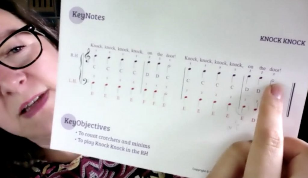 Piano lessons on Zoom Pointing to a page